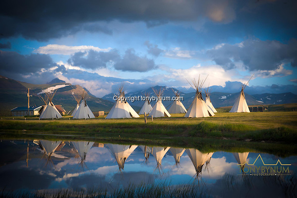 Blackfeet Tipis on the Blackfeet Indian Reservation, Montana. Glacier National Park is in the distant background. Montana Photographs (Tony Bynum/tonybynum.com)