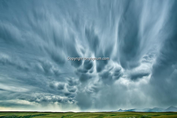 Big Sky's and summer storm along the Rocky Mountain Front, Montana. Montana Photographs (Tony Bynum/tonybynum.com)