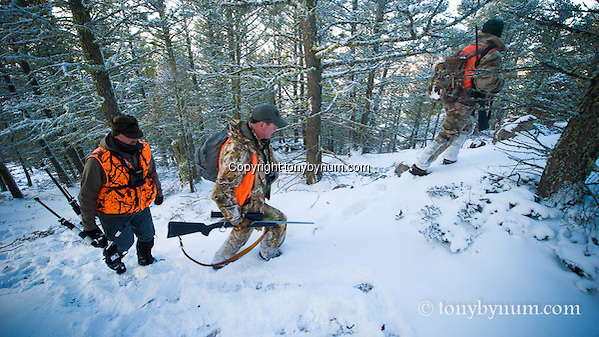 Hunters hunting though the snow covered forest of montana. Montana Photographs. (Tony Bynum/tonybynum.com)