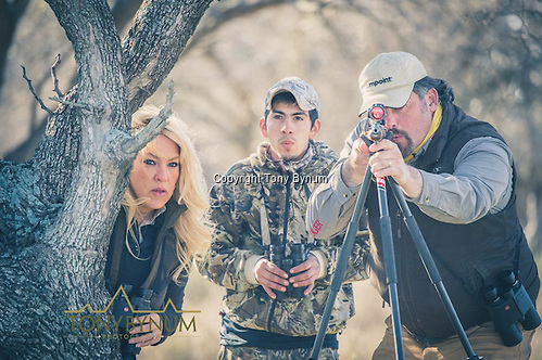 Tom and Olivia Opre and guide Saul Miranda hunting in Argentina. Tom and Saul are whistling to get the animal to position for the shot.  @tonybynum.com