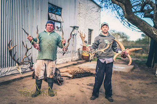 Skinners holding two blackbucks, one four horned ram, and a fallow dear. Los Molles, Ranch. La Pampa, Argentina ©tonybynum.com