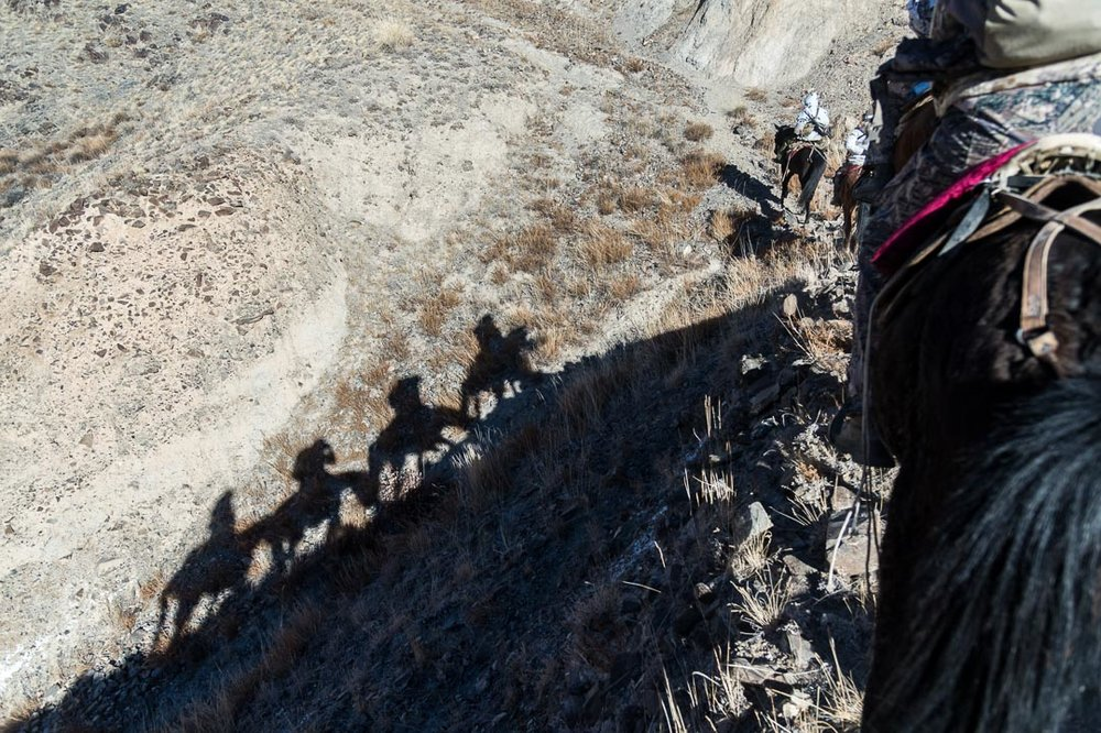 Riding horseback up a ridge, Tian Shan Mountains, Kyrgyzstan. © Tony Bynum