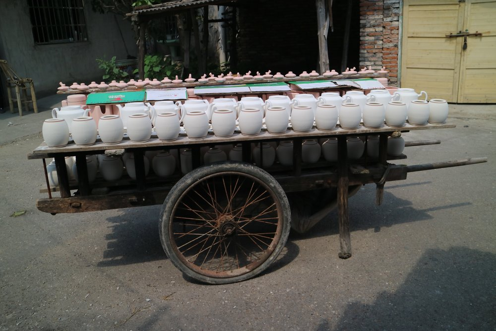 pushcart of teapots