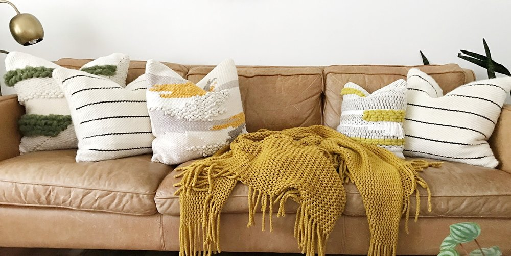 PILLOWS - Handmade in our sunny studio in Charleston, SC, each pillow is handwoven on a frame loom and then cut and hand sewn. Depending on the size and style of the pillow, each one takes 5-8 hours from start to finish. These pieces are truly one-of-a-kind, adding warmth, color and texture to any home.
