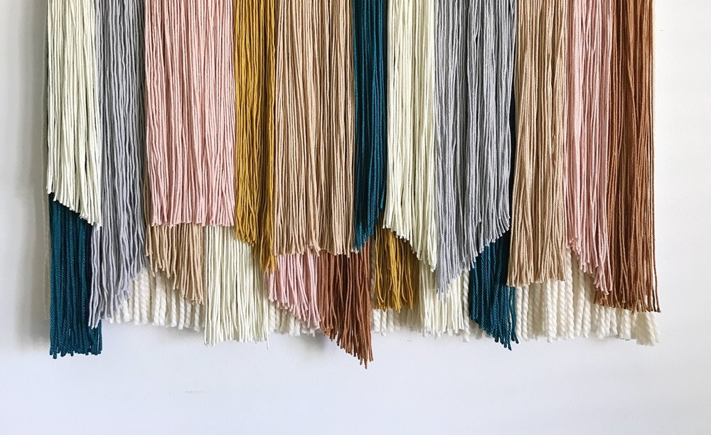 WEAVINGS - Handmade in Charleston, SC, each weaving is made with bold color combinations and a variety of textures and materials. Each one of a kind piece is thoughtfully crafted by hand adding warmth,  happiness, and color to your home.
