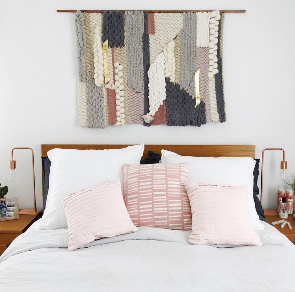 """I had been wanting a weaving for close to a year but hadn't been able to find the right one, until I found Erin's Instagram. I immediately fell in love with 4 different styles, each completely different from the other. I emailed Erin to talk about creating a custom piece for above our bed. We went back and forth, I showed her our bedroom, told her what colors I was thinking, she sent me pictures of different yarns and once we agreed on the style and colors, she got to work. She sent me updates along the way with pictures of the progression and when she finished, styled shots of the weaving. Now it hangs above our bed and I kid you not, I look at it every single day and smile. It brings so much happiness to our home and ties everything in our room together.""   Ashley Hosmer,  @ashleyhosmer"