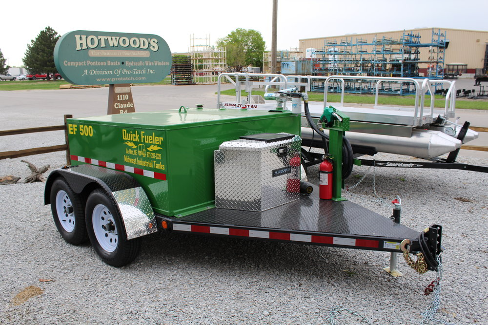"500 gallon Quick Fueler shown on DOT approved trailer, equipped with electric 15 gpm pump, hose and nozzle, nozzle stand, fire extinguisher, battery, solar charger, Lund aluminum tool box, 2 5/16"" ball hitch, LED lighting, torsion axles, new radial tires and John Deere green premium powder coat paint. Like all our fuel tanks, this tank is UL Listed 142-A.  A trailer set up like this is ready to go when you pick it up or when it is delivered. Everything is tested to make sure you will be completely satisfied when you get it.  These trailers pull very comfortably down the road, as we all have towed trailers that beat you to death while on the road. We guarantee, you will be very satisfied with the way our trailers tow. Hotwood's, will always go that extra mile, to get your tank and trailer delivered the most economical way possible, without compromising the quality of your delivery.  Call toll free for pricing and delivery options. 877-407-8645"