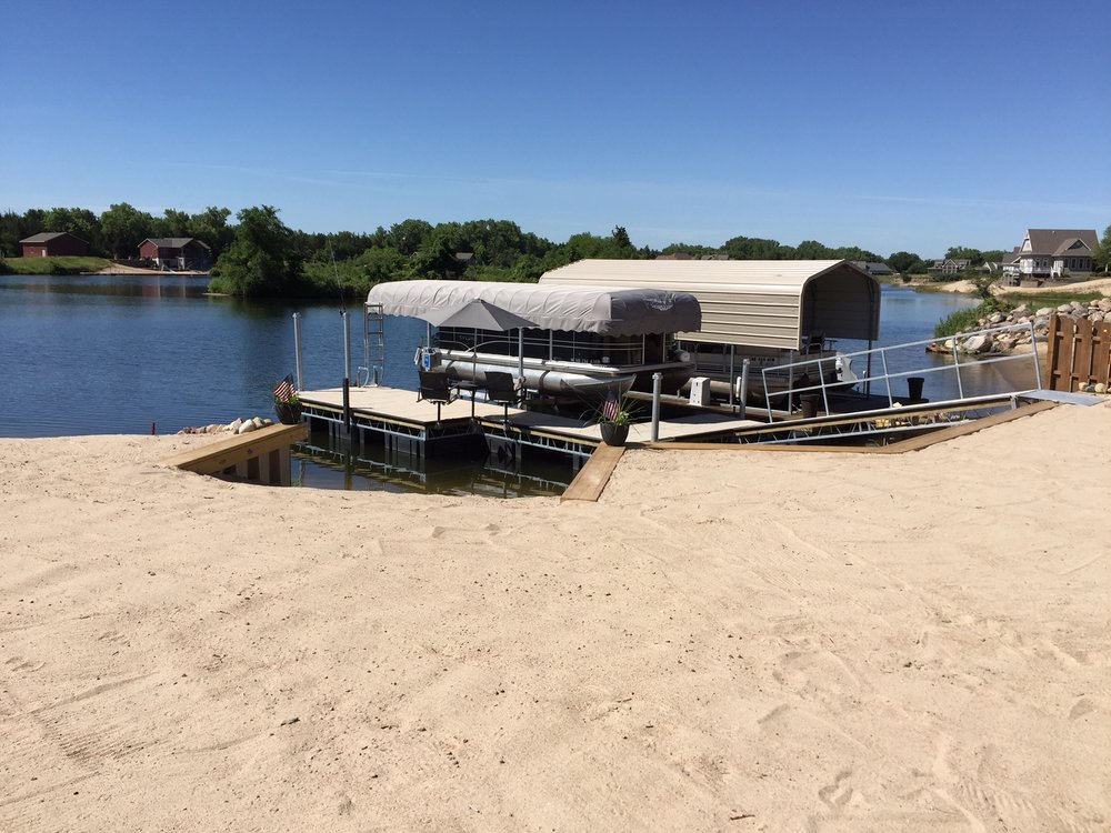Shoremaster concrete dock and boat lift with cover, installed by Hotwoods in Central City, Ne.