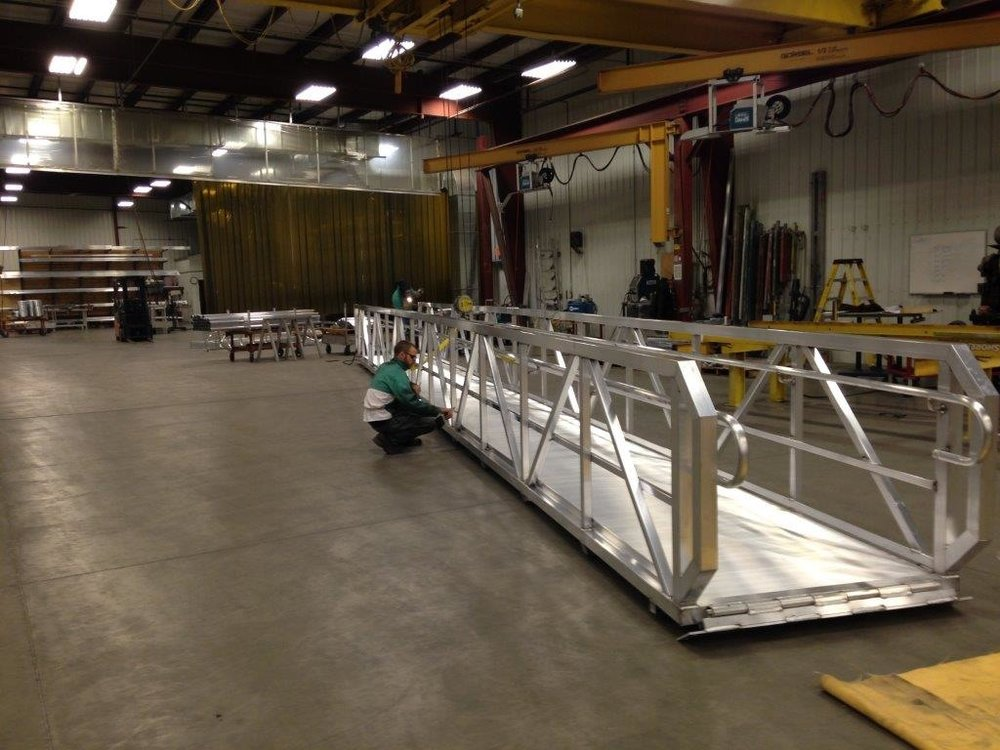 Custom designed and manufactured for the State of Nebraska, this 50' x 5' all aluminum walkway is a fine example of what our capabilities are when it comes to satisfying the customer. This unit was installed in the McCook, Nebraska area.