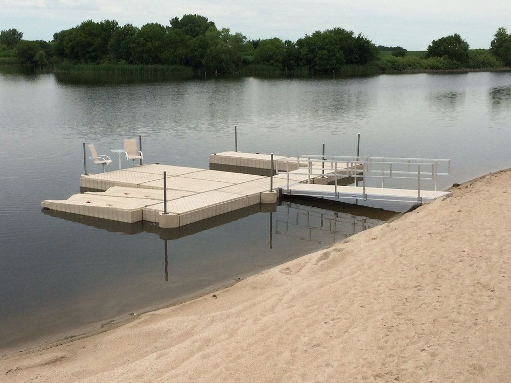 Shoremaster poly dock with 2 jet ski shore ports and Hotwood's aluminum walkway installed by our crew in Garland, Ne.