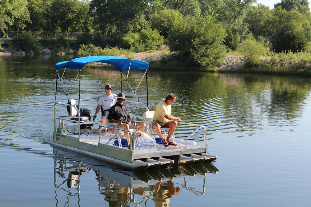 "Check out the all new 716 Aluma Sport pontoon boat we are introducing for 2018. With 1,600 lbs. of capacity and a 25 hp rating, you will have the ability to carry more weight and move across the lake at faster speeds to get to those favorite fishing holes or locations across the water.  ( Boat above is shown with optional canopy top, seating and 25 hp. outboard motor.)  This 7' wide x 16' long all aluminum pontoon boat is packed with ( 6 ) 12"" floats that by far give it the most stable platform in the industry for a boat this size. Pontoons are .090 thick aluminum, with .100 thickness on cones and end caps.( That is the heaviest in the industry ) The 716 Aluma Sport weighs 875 lbs, with the trailer weighing 620 lbs. for a combined pulling weight of 1,495 lbs. That makes it very easy to pull with the lightest pickup or like vehicle on the road. We are personally involved with every boat we have ever designed or manufactured, and after 2 years in development, we can say, this boat is incredible when it comes to maneuverability and stability. We have just never seen anything like it on the water. This craft is literally like walking around on your patio.  Quality, you need not question the construction of this boat, like all our pontoon boats and docks we manufacture, there is nothing to compare them to. The 716 Aluma Sport is manufactured completely of aluminum with stainless steel hardware. We tell people everyday they could bury this boat and dig it up 20 years later and go boating.  We are now in full production and taking orders on the 716 Aluma Sport and Shoreland'r trailer. ( Please call for pricing and delivery dates toll free 877-407-8645 )"