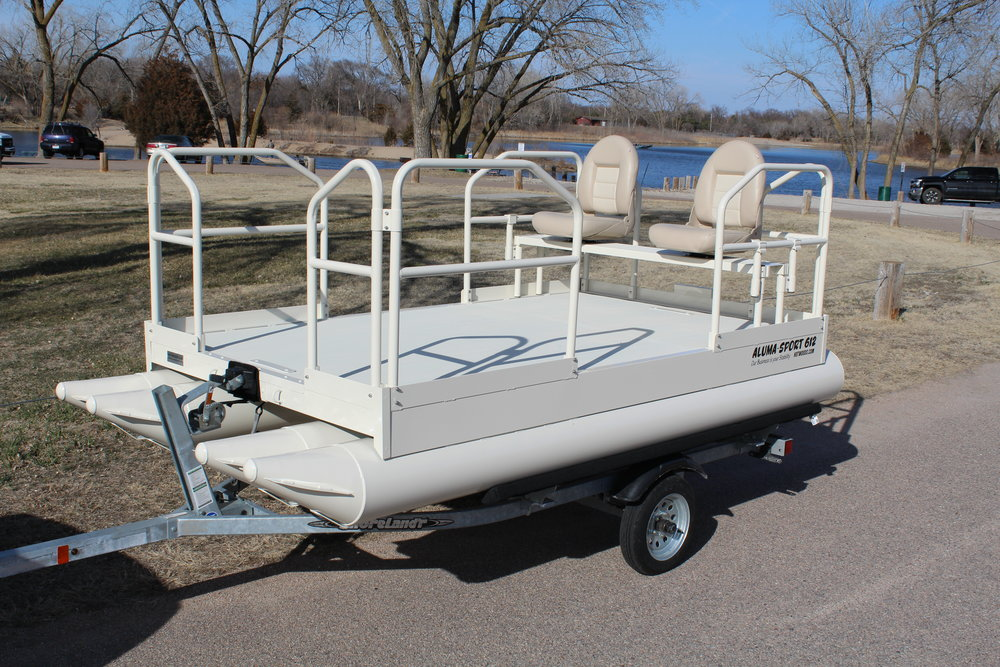"612 Aluma Sport shown in custom color, Cedar Rapids White. This customer added the optional 34"" handrails all around and the up graded folding seats.   Hotwoods offers premium powder coating to all out pontoon models except the 716 Aluma Sport. This color was a custom color that we normally do not offer, but was requested by this customer.  Hotwoods filled the wish to give the customer exactly what they wanted. It is a very creamy white that is a real hit with everyone that has seen it so far.   Customers ask, what is the price difference of a custom color? The answer to that is, there is an up charge for premium powder coating and it can vary depending on color. Remember, we will always go that extra mile to give you what you want and at the same time, doing it the most economical way possible, for you the customer."