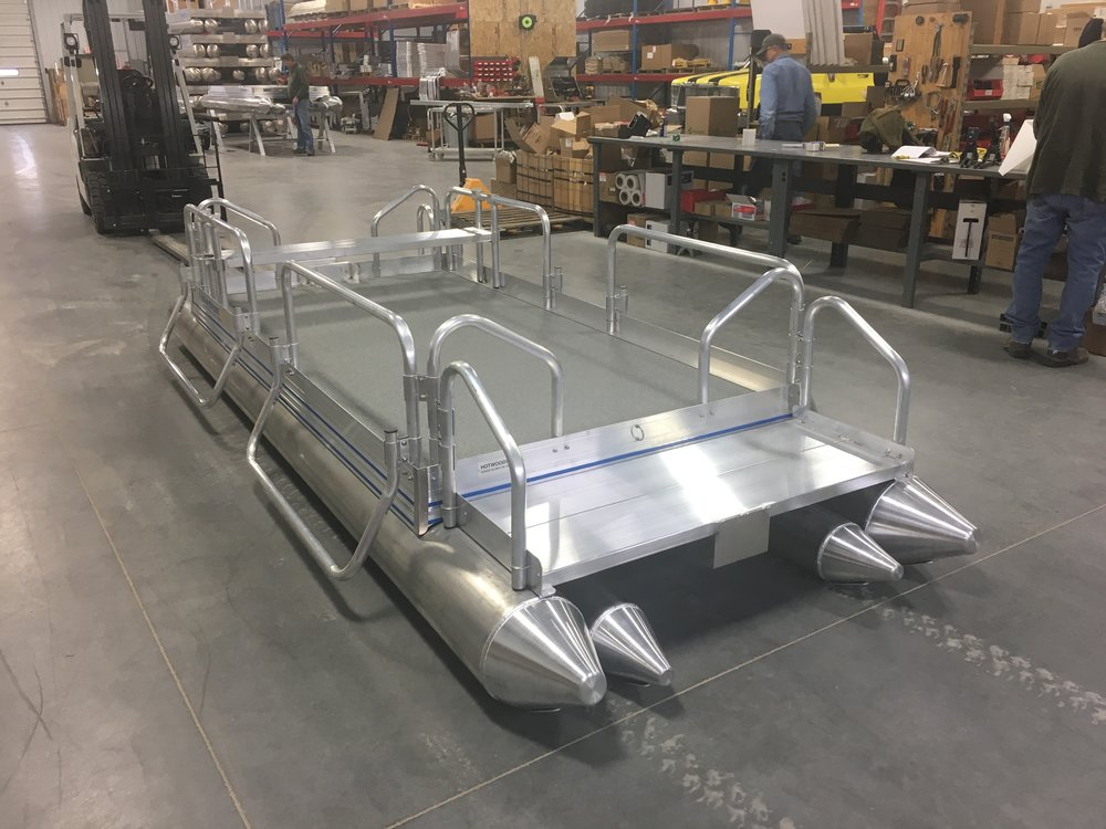 Many customers do not need a trailer with their boat. This Fish N Sport awaits its new owner that has chosen not to purchase a trailer. Hotwood's will load your new boat on your trailer when you arrive to pick it up. Most flatbed type car trailers will work fine to haul your boat home as long as it is wide or long enough to set the boat on.