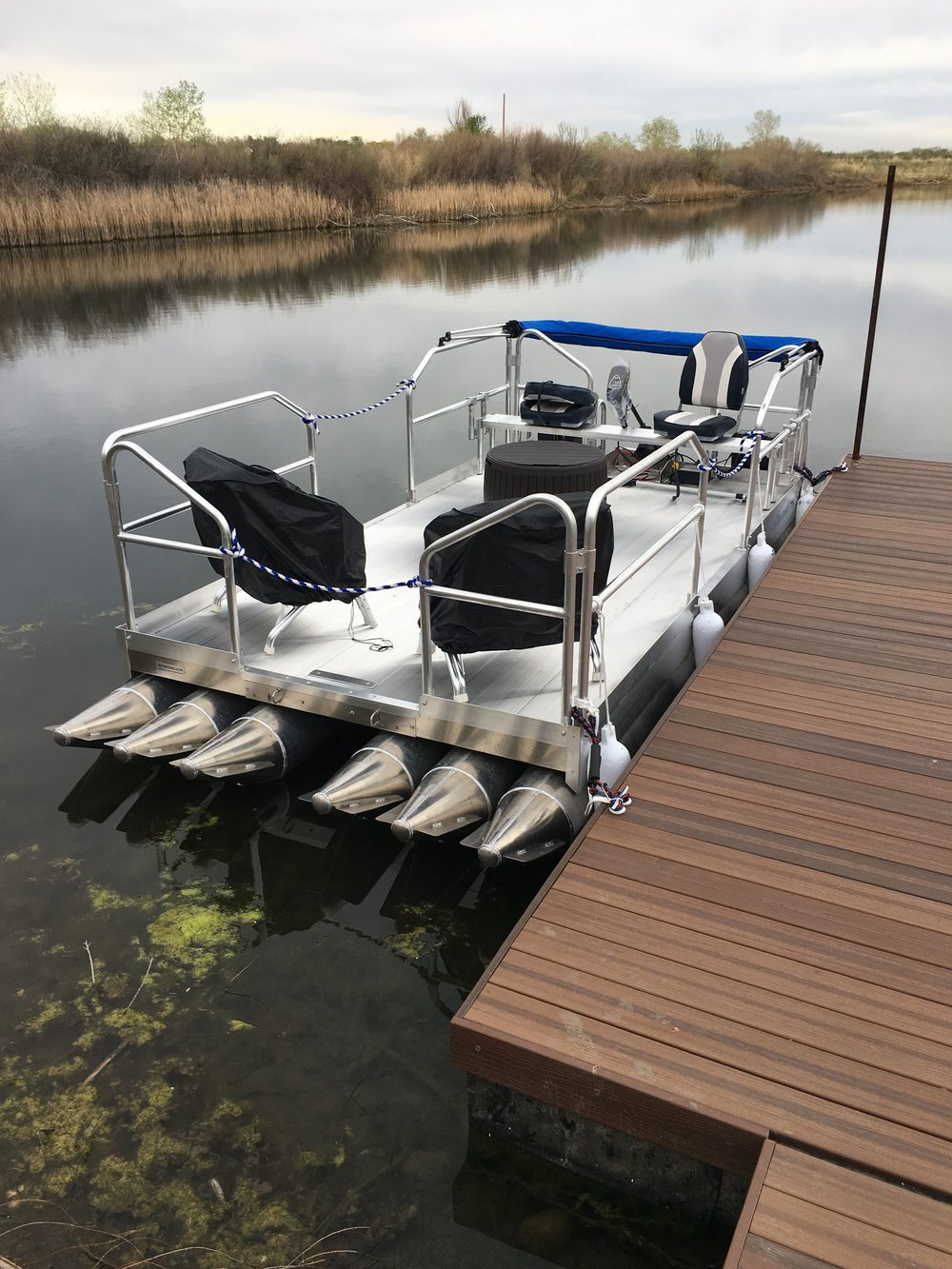 As you see with this customers 716 Aluma Sport, it is possible to have chairs or tables anywhere you want with all the available floor space. This is a great example of what your 716 could look like on the water with a few optional accessories.