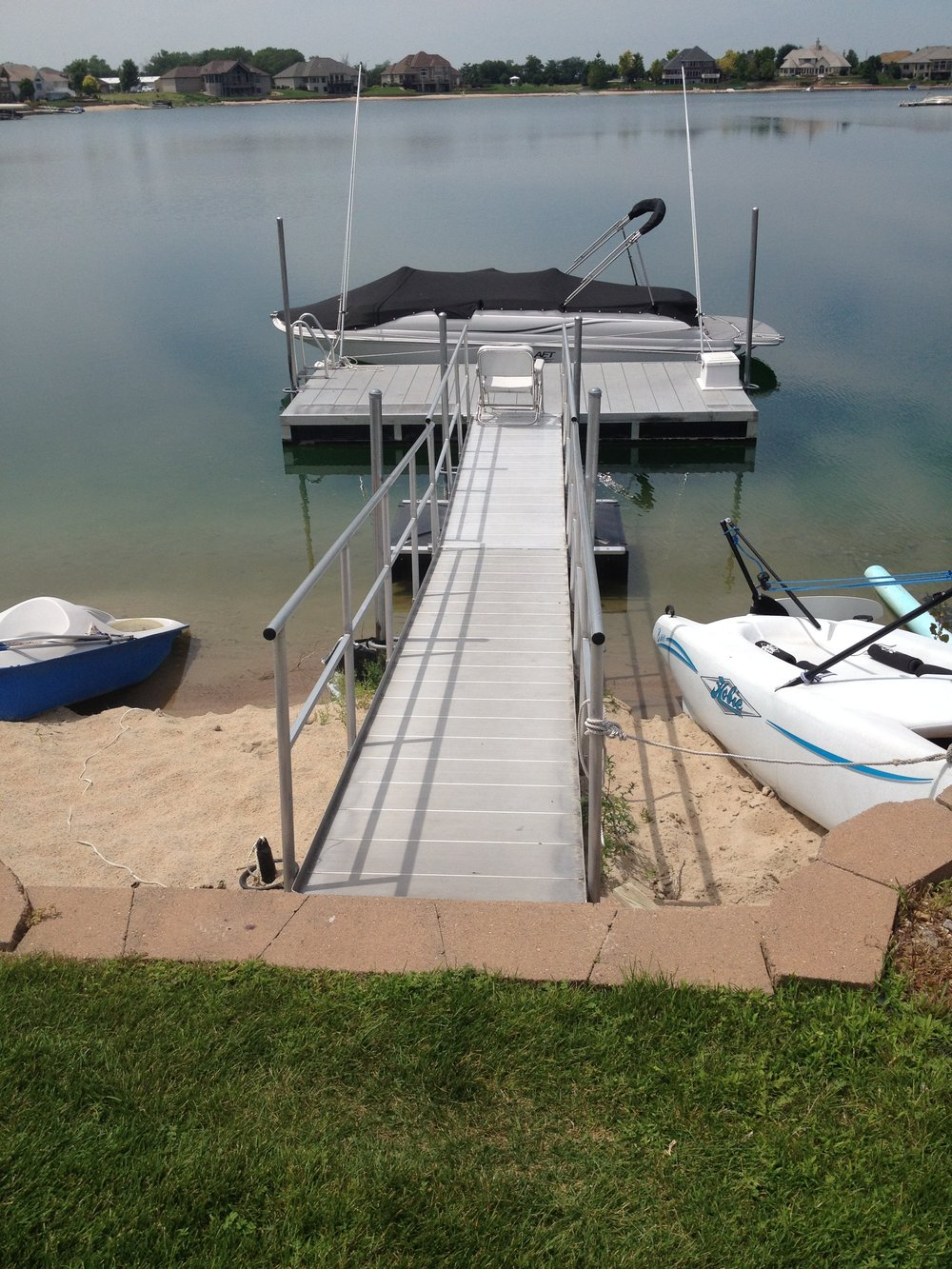 Hotwood's 816 aluminum dock and extended aluminum walkway installed in Grand Island, Nebraska. This is a life long dock that needs very little maintenance over the years.