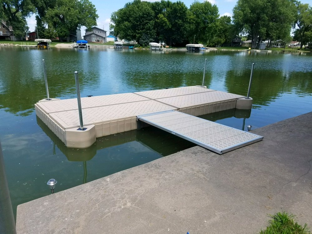 Shoremaster brand poly dock installed by Hotwoods crew at Johnson Lake just south of Lexington, Ne. This is 4 poly floats measuring 4' x 8' connected to create a 8' x 16' dock with a 3' x 8' walkway. This is as clean and simple as it gets.   Here at Hotwood's we stock and service the full Shoremaster line, along with our own line of all aluminum docks and walkways.  You will not be dissappointed.