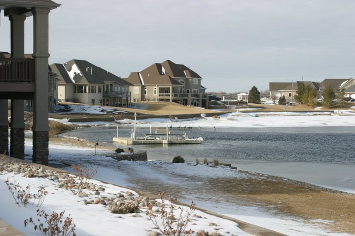 Tired of worrying about your dock or boat lift all winter when the lake freezes over? With our ice eaters you can lower it in the water and plug it in and forget it. It was 7 degrees when this picture was taken and had been below 15 degrees for multiple days before. As you see with all the open water around the dock and lift, this customer does not need to wonder what spring will bring.