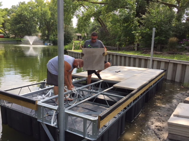 Hotwoods contractor crew installing a concrete floating Shoremaster dock in Grand Island Nebraska. As you see this style of dock is very labor intensive, but the end result is fabulous.