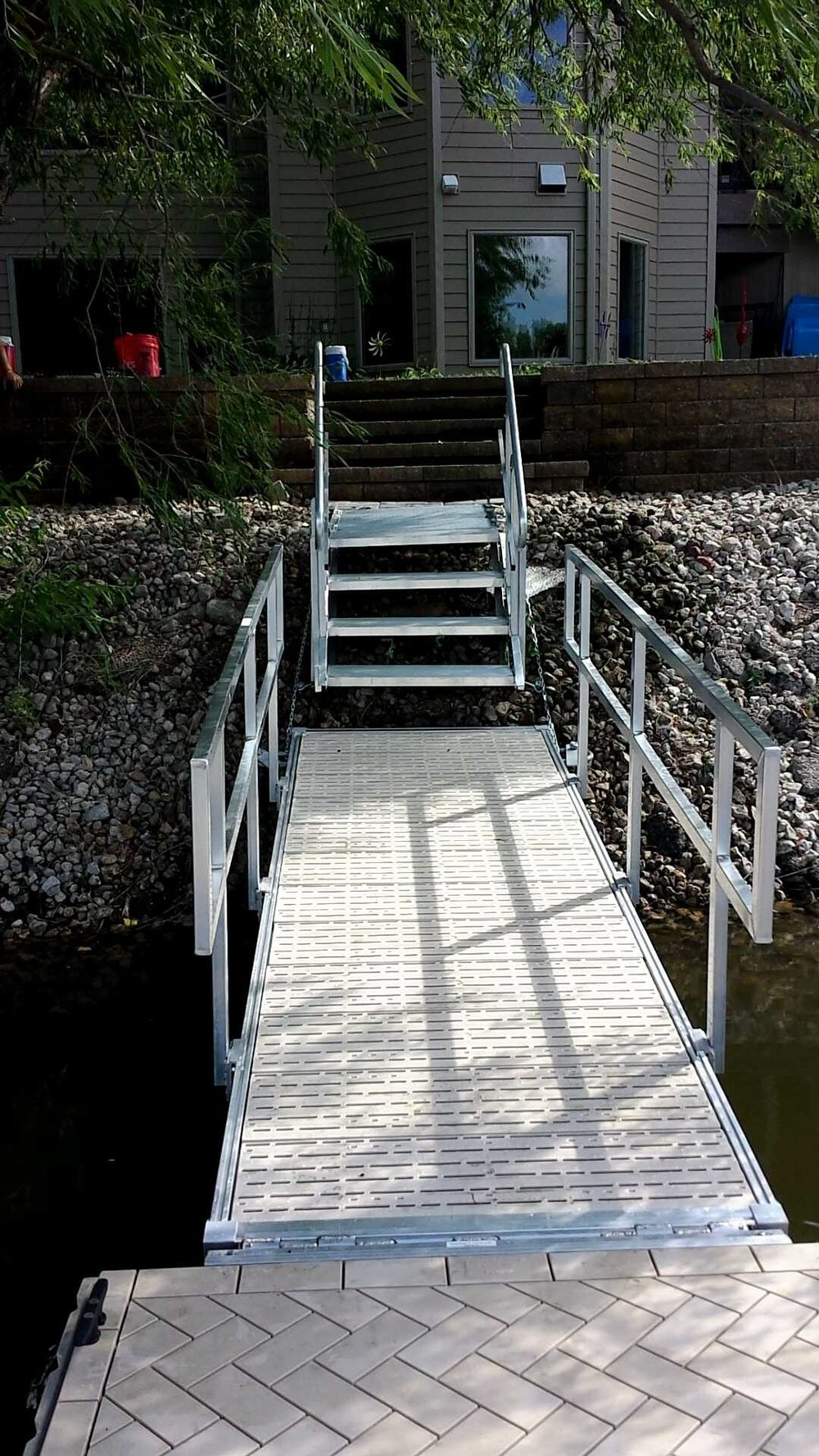 Anywhere stairs installed by Hotwood's to get down this slope to the walk way and the dock safely.
