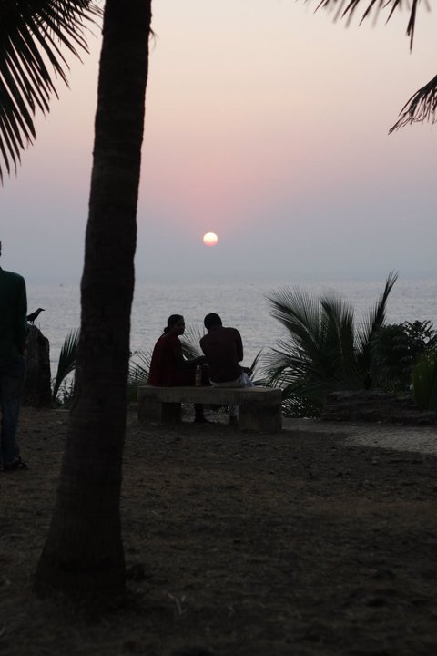 A couple watches the sunset on Valentine's Day in Mumbai, 2010.