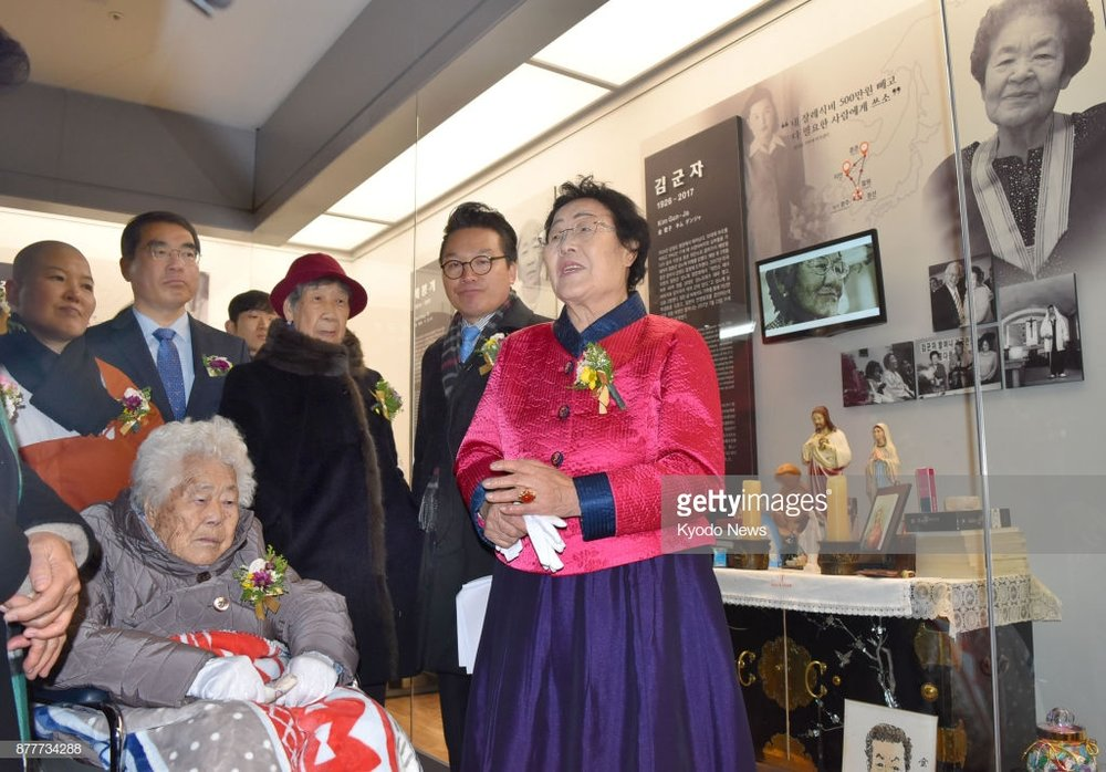 """Lee Yong-Soo  halmuni  (grandmother) speaking to reporters in front of an exhibit memorializing the lives of """"comfort women"""", which features my translation work."""