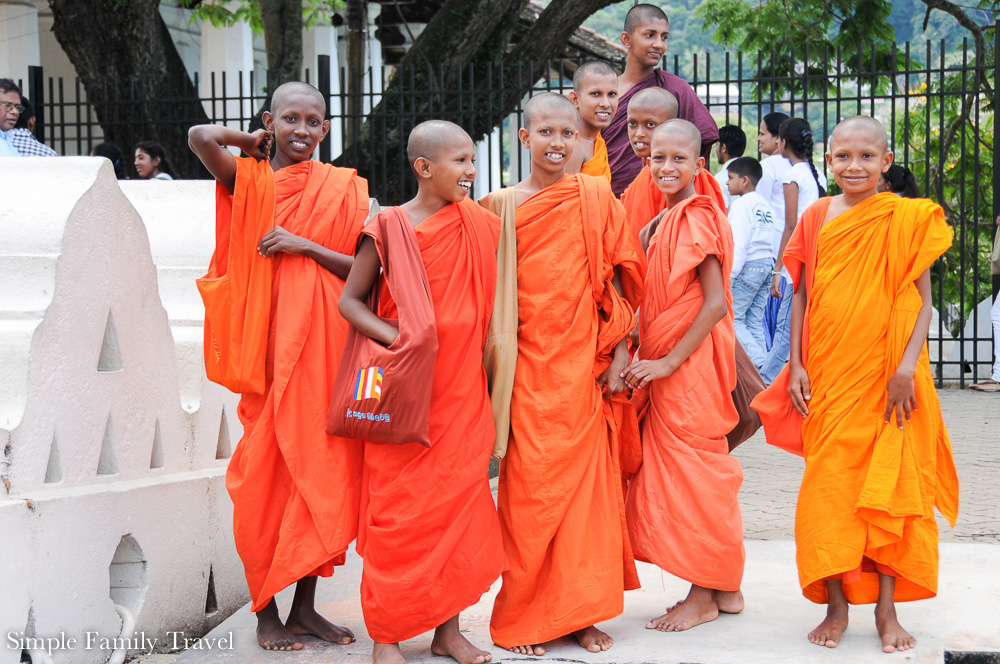 Outside the Temple of the  Sacred Tooth Relic, my sister Mel snapped these Monks in training.