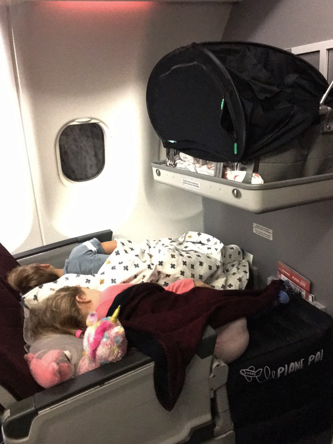 Three kids fast asleep! Now looks like a relaxing flight. Photo Credit: Bronwyn.
