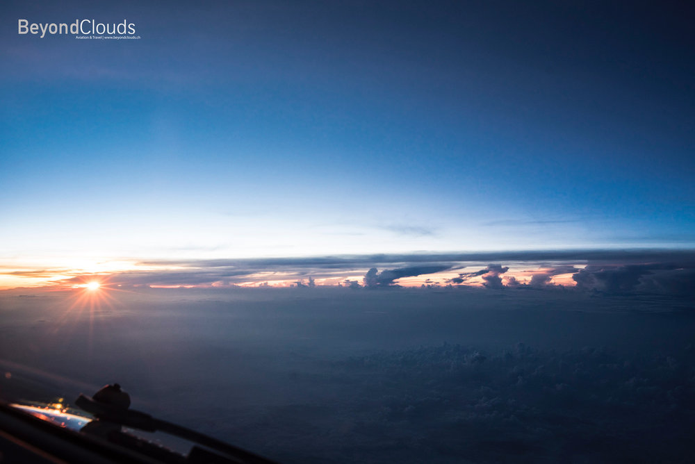 We are just reaching the airspace of Myanmar as the sun slowly peeks above the horizon. A beautiful sight with impressive thunderstorms along the horizon.