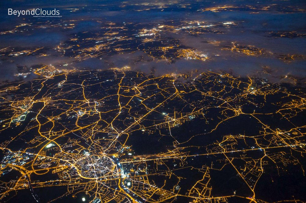 Like drawing a map. Flying over the state of Belgium during dusk show the massive network of roads.