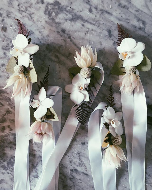 Bridesmaids wrist corsages from Saki & Roberts beautiful Ikebana inspired wedding, produced by @hilde.stories  #stilllifeflowers #hildestories #stilllifeflowerswedding #wristcorsage #ikebana #orchid #bridesmaidcorsage