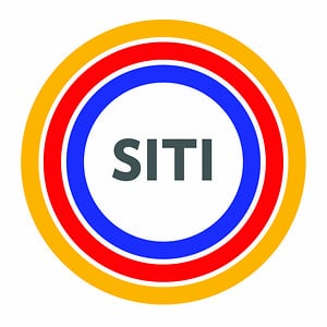 Siti Theater Company Logo. The letters SITI inside three concentric circles in orange, red, and blue. Belinda Mello is a guest teacher at the SITI Conservatory with Anne Bogart.