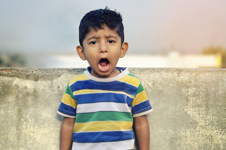 A little boy opens his mouth wide to express himself. Actors can learn a lot through his unabashed expression and lack of physical holding.
