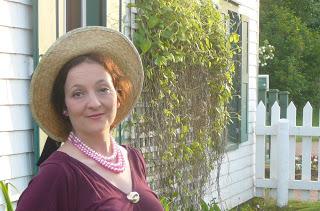 Picture Julia Lenardon, voice, speech, and accent coach outside of a picturesque house.
