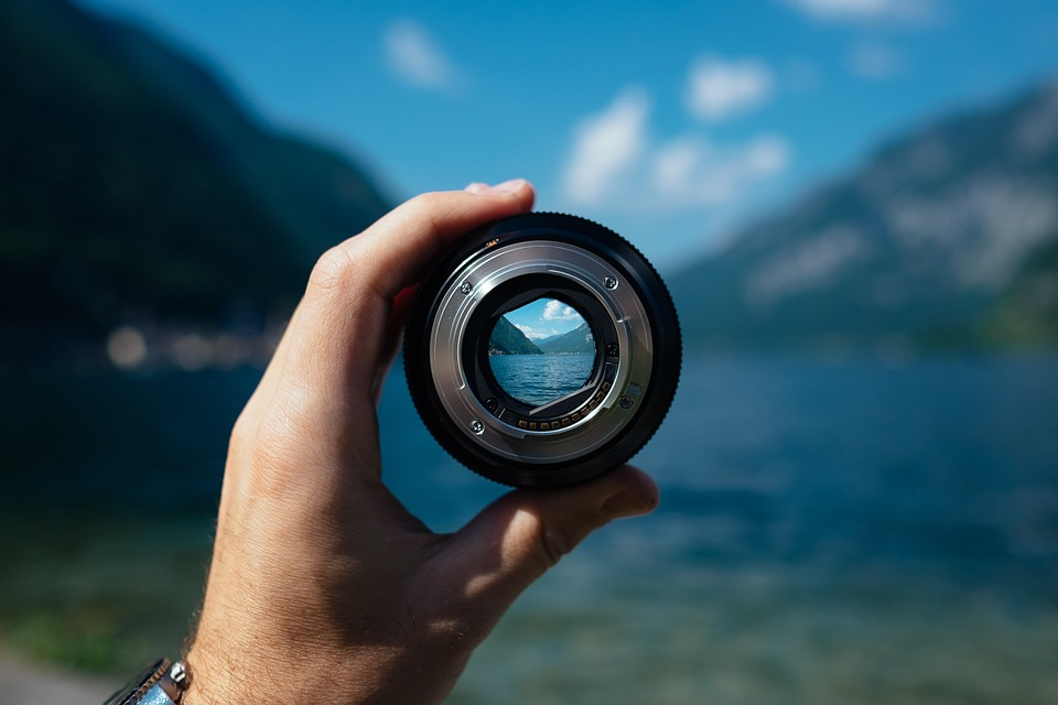 A Camera Lens shows a distant point in a valley in focus while the rest of the image is blurry. This helps us see how we can use our own energy as a theatrical tool of focus.