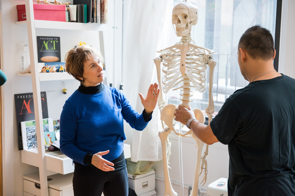 Belinda shows an actor the width o the lumbar spine. We are supported by a very thick column of bone and muscle.