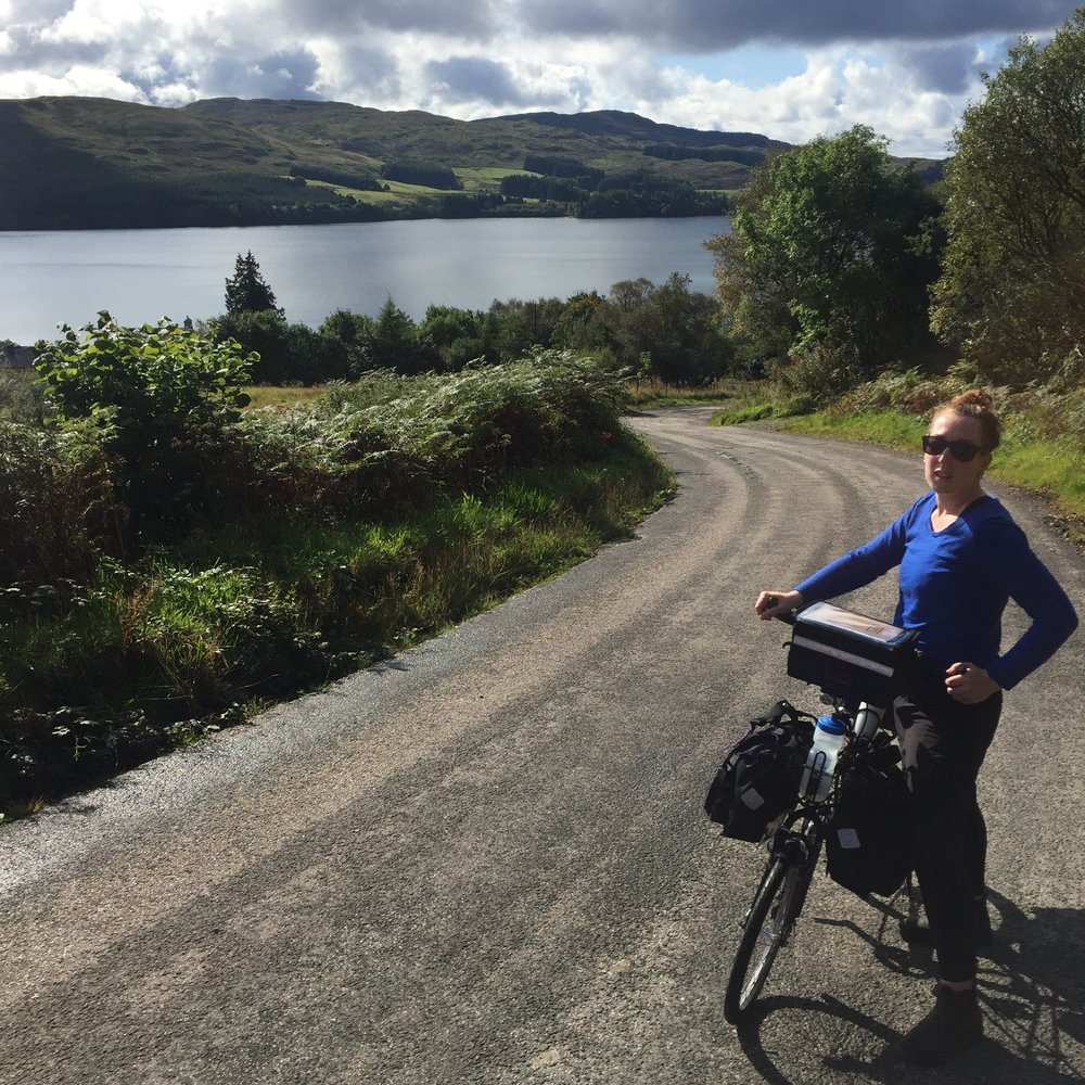 Kate touring Scotland on a Moulton TSR