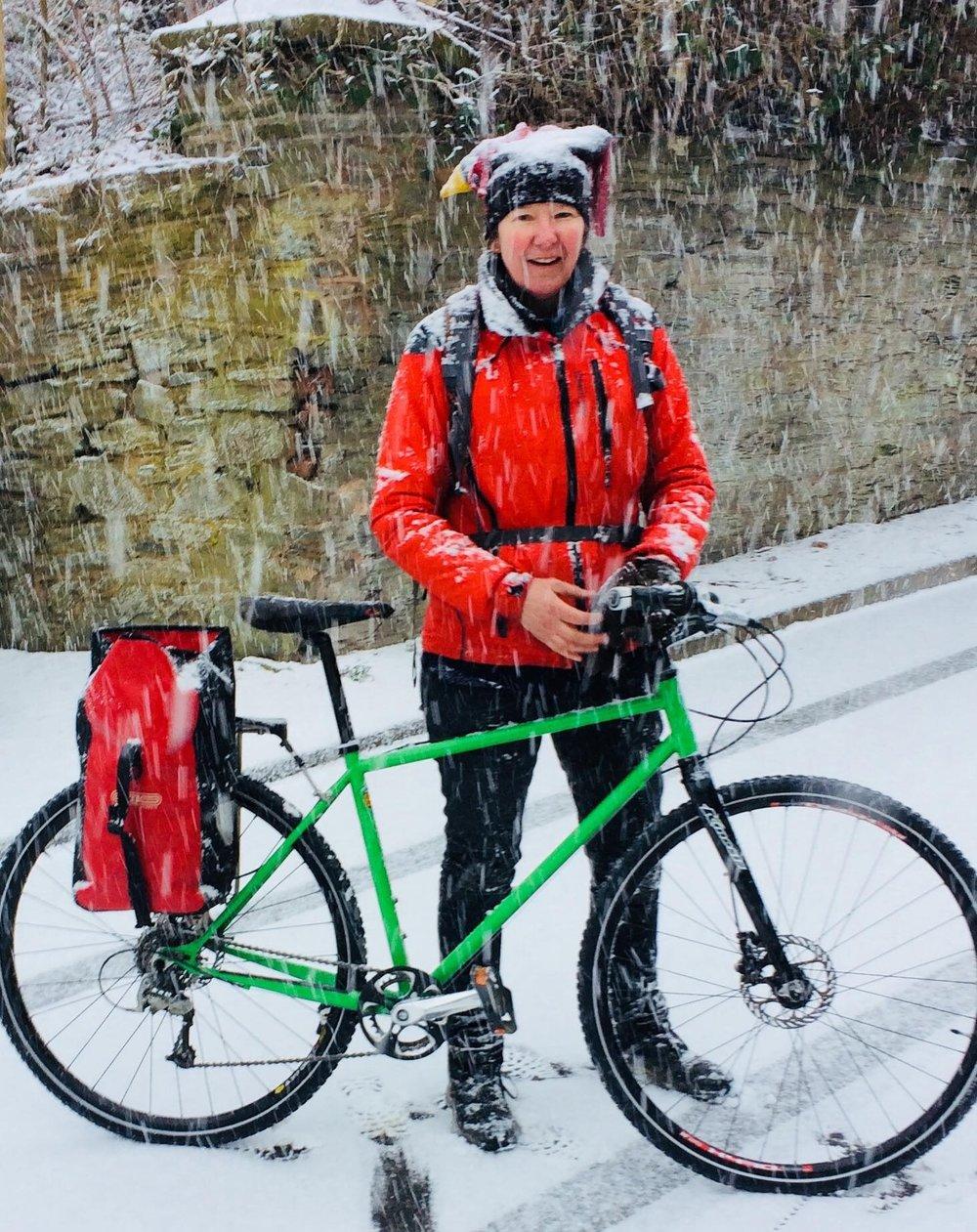 Liz and bike snow.jpg
