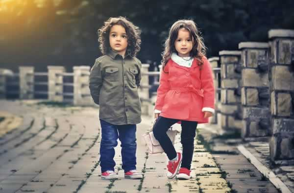 little boy and girl on a bridge