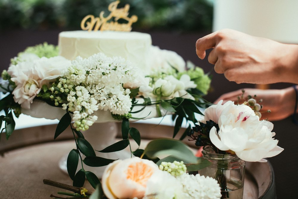 Flowers surrounding cake : Hanoi Ranunculus | Syringa | Peonies | Italian Ruscus