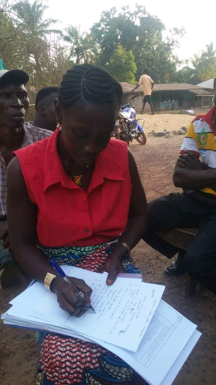A woman filling out a survey as part of the needs assessment.