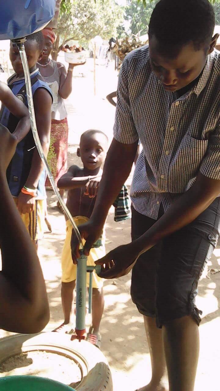 Usifu setting up the LifeStraw water purifier.