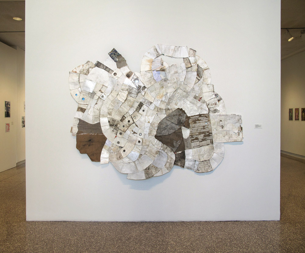 Spandrel  (Leslie, MI to Hastings, MI)  2009, found paper, Styrofoam, and plastic  (throwaway materials gathered on collection-walks) 96¨ x 80¨ x 5¨