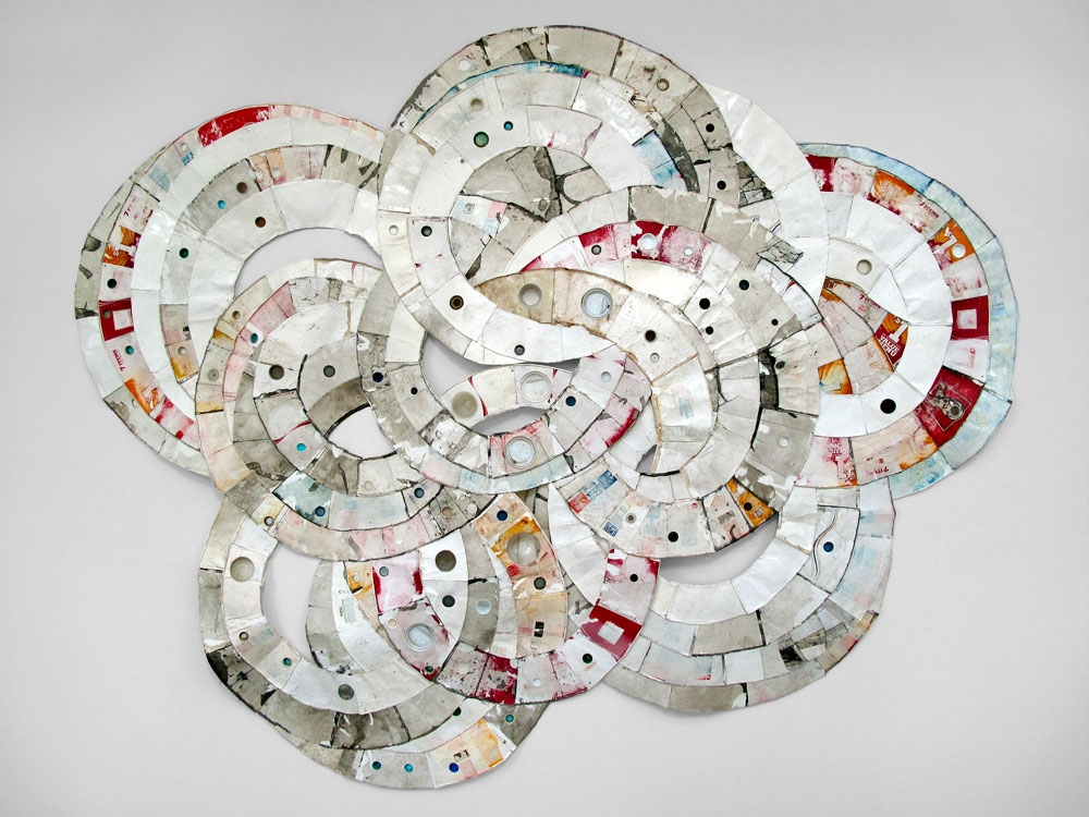 Moly   (Kennan, WI to Eau Claire, WI)  2010, found paper, Styrofoam, and plastic   (throwaway materials gathered on collection-walks);  120¨ x 90¨ x 4¨