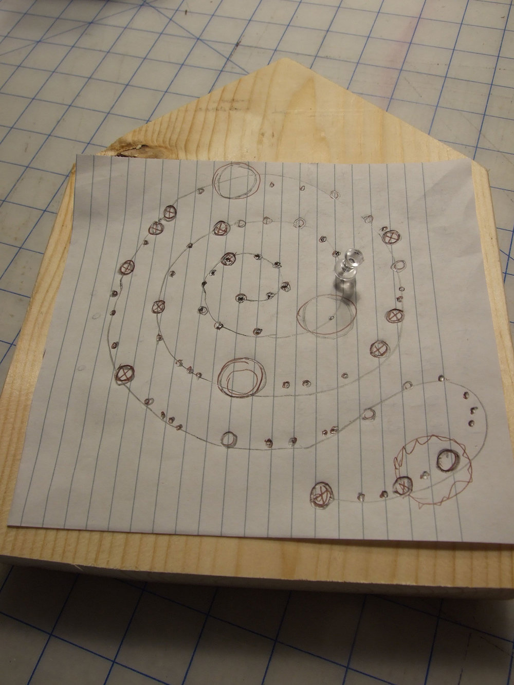 Using a simple spiral pattern, I plotted a series of holes on a piece of paper. Using a push pin I marked the position of each dot.