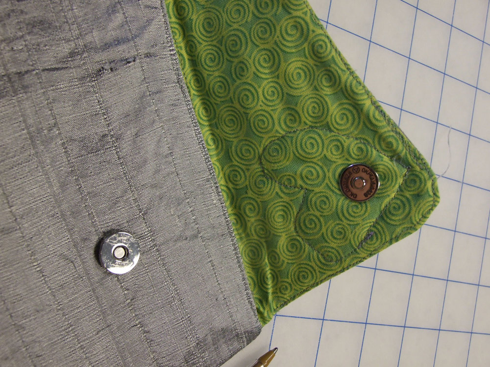 . After the purse was done I decided to add a magnetic closure. If you've never used them, do give it a try. They're fast and easy - no sewing, just two little holes and attach the backing!