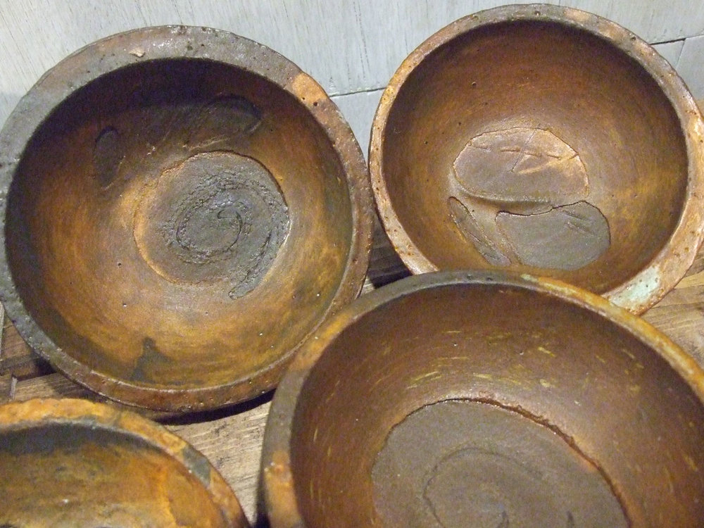 Rusted cement bowls with stitched paper inclusions