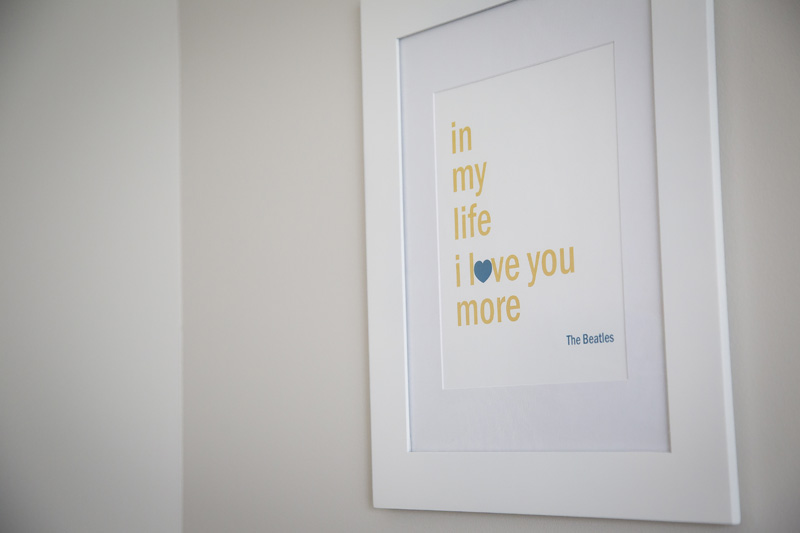 01-lifestyle-newborn-in-home-session-baby-room-wall-art-in-my-life-i-love-you-more-the-beatles-melanie-mahonen-photography