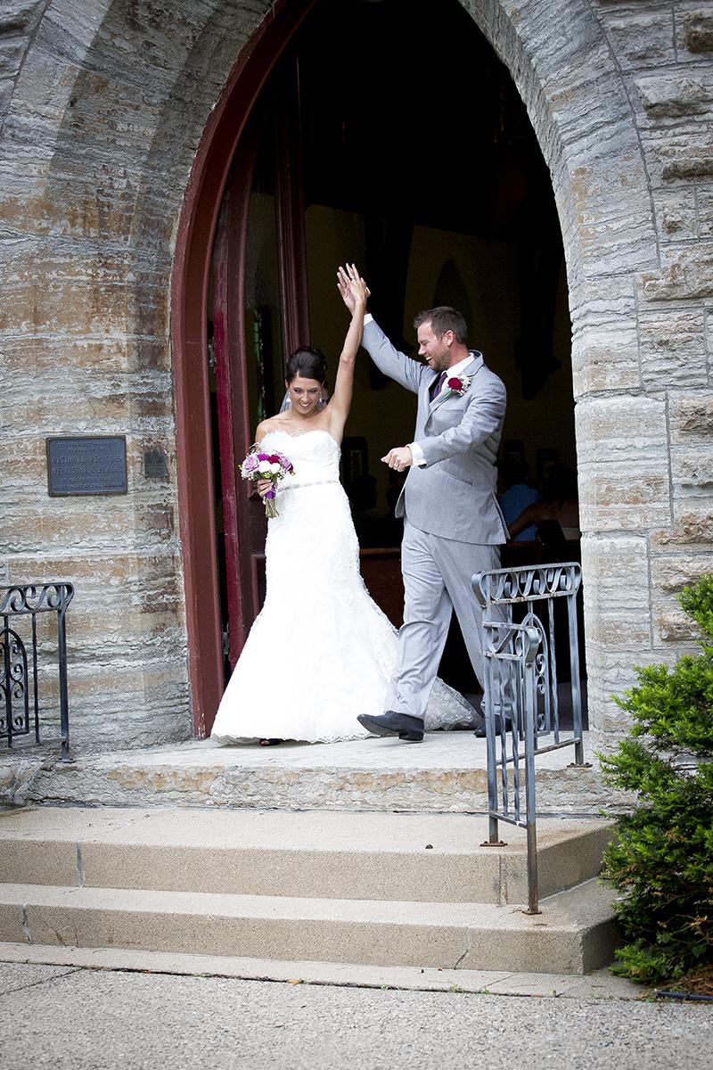 chirch-wedding-exit-bride-groom-happy-melanie-mahonen-photography-faribault-minnesota