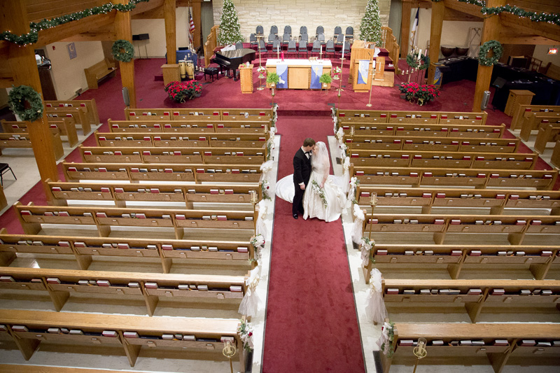 09-peace-lutheran-church-coon-rapids-minnesota-bride-groom-empty-sanctuary-pre-ceremony-melanie-mahonen-photography