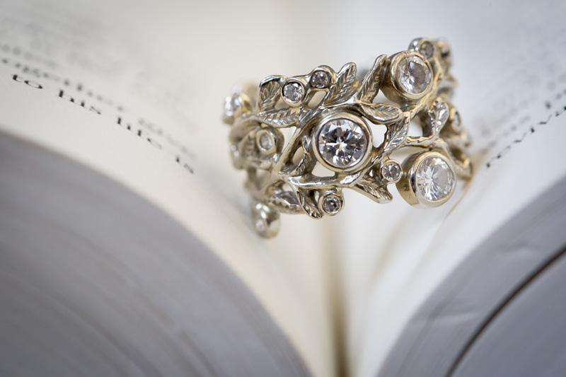 02-stunning-engagment-ring-recycled-metals-library-engagement-session-ring-detail-shot-book-melanie-mahonen-photography